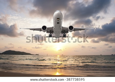 Airplane Landing in sunset light on the beach