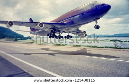 airplane landing on a highway - stock photo