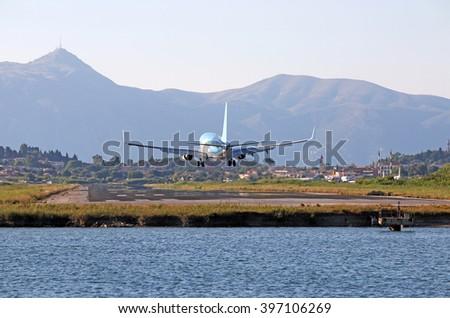 airplane landing on Corfu airport - stock photo