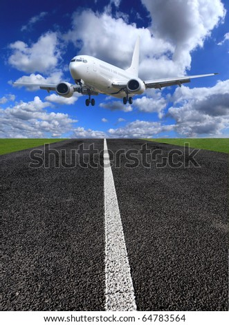 Airplane landing on runway - stock photo