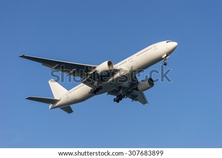Airplane landing to the airport. - stock photo