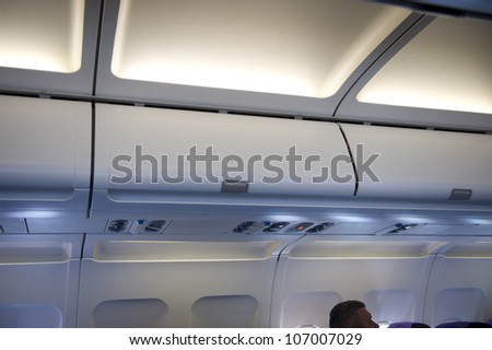 airplane locker overhead stowage - stock photo