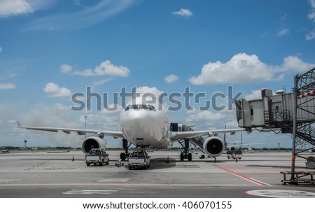 Airplane near the terminal in an airport cockpit shoot on the bus - stock photo