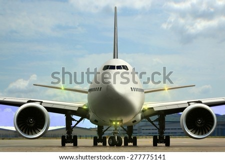 Airplane on airport runaway - stock photo