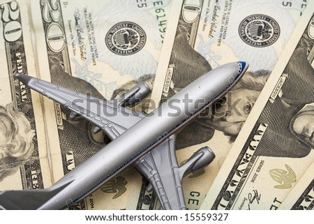Airplane on Money, the rising costs of airline travel