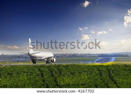 Airplane on runway - stock photo