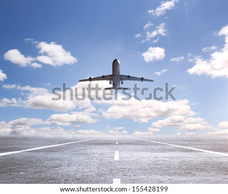 airplane on runway and looking at airplane in blue sky - stock photo