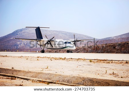 Airplane on runway before taking off  - stock photo