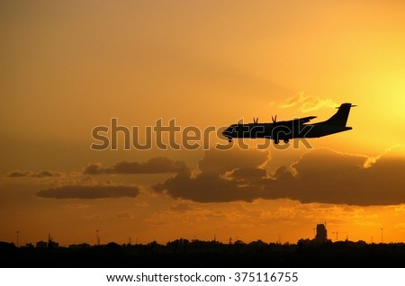 Airplane on sunset