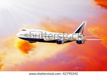 Airplane on sunset sky