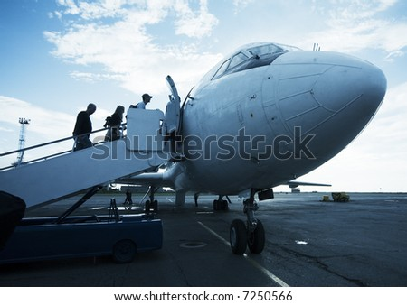 airplane on the airfield with a ladder - stock photo