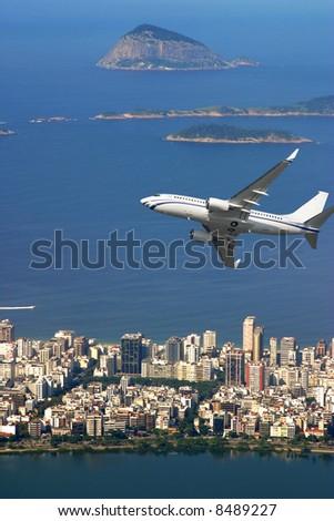 Airplane over Ipanema beach in Brazil - stock photo
