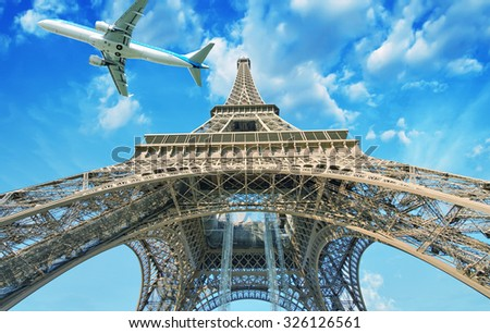 Airplane over Paris, France. Tourism and vacation concept. - stock photo