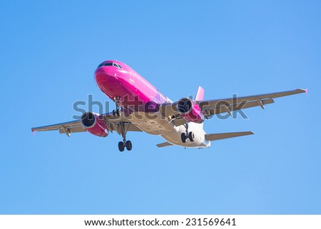 Airplane over the blue sky - stock photo