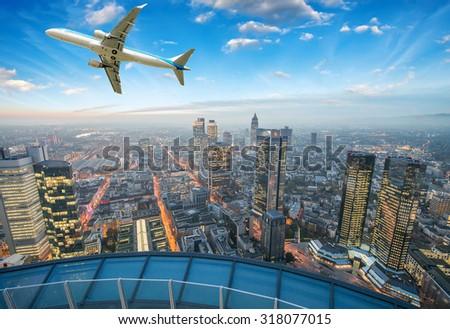 Airplane overflying Frankfurt. - stock photo