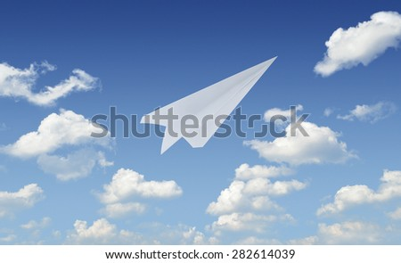 Airplane paper flying in blue sky, leader business concept