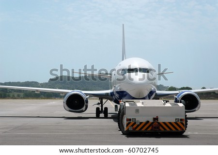 Airplane parked in the airport - stock photo