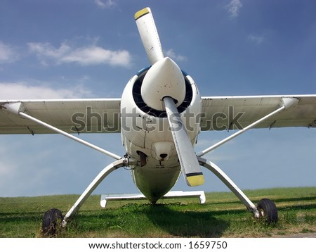 Airplane parked on meadow - stock photo