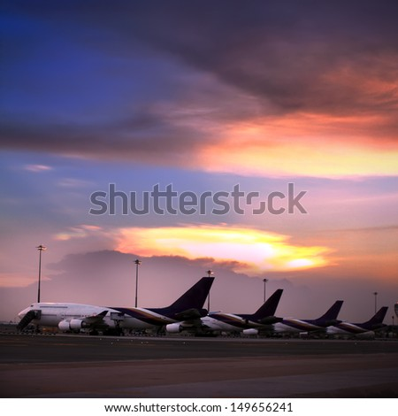 Airplane parking at the airport  - stock photo