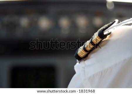 airplane pilot shoulder with uniform - stock photo