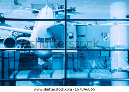 Airplane plane at terminal gate ready for boarding. - stock photo