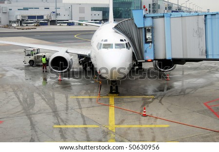 Airplane preparation for departure on an airport
