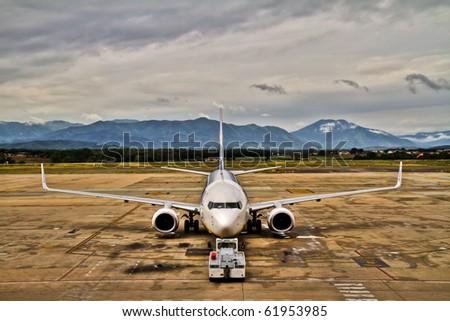 Airplane preparing to flight - stock photo
