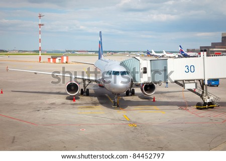 Airplane preparing to the flight - stock photo