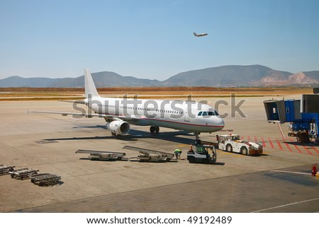 Airplane preparing to the flight at airport - stock photo
