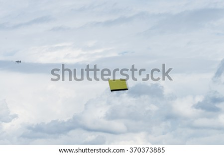 Airplane pulling an ad (fill in your own text) - stock photo