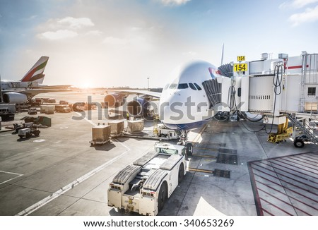 Airplane ready for boarding in a airport hub - stock photo