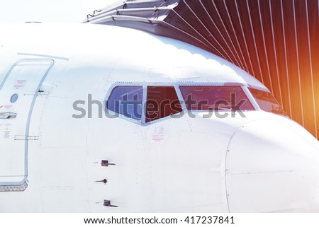 Airplane ready for boarding in a airport hub. - stock photo