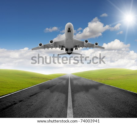 Airplane ready to fly in a green airport - stock photo