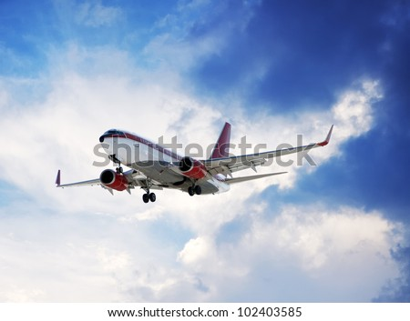 airplane surrounded by dark clouds - stock photo