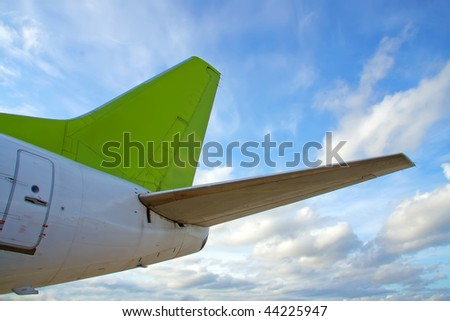 airplane tail, blue sky, cloudscape