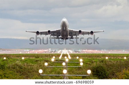 airplane take off at manchester airport, england, uk. - stock photo