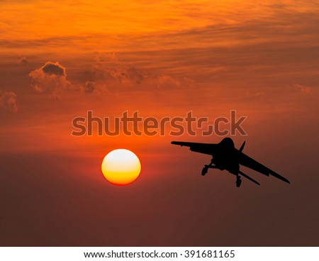 Airplane take off at sunset.