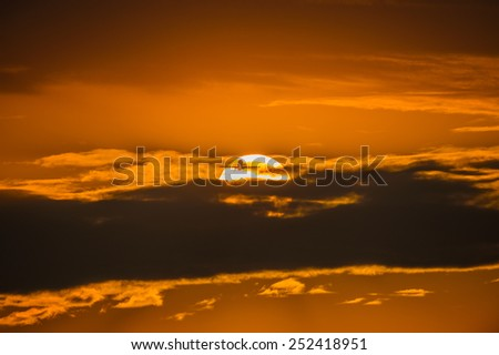Airplane takeoff in beauty sunset with sun behind clouds - stock photo