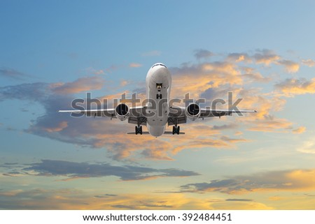 Airplane takeoff in sunrise - stock photo