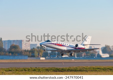 Airplane takes off at airport. Business Jet on the runway - stock photo