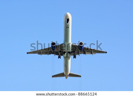 Airplane taking off from front below
