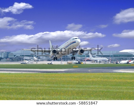 Airplane taking off from runway - stock photo