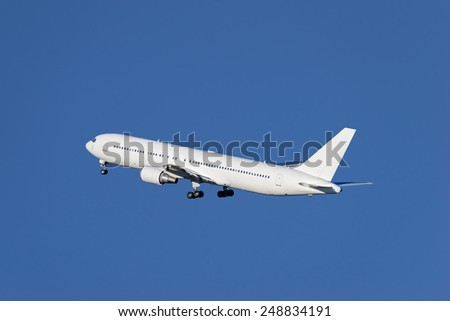 Airplane taking off from the airport. - stock photo