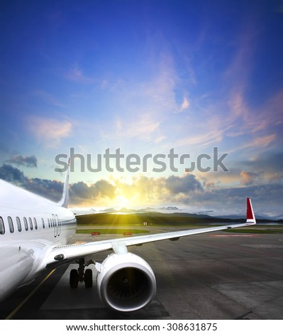 airplane taking off from the airport. fragment of the body of aircraft. business travel concept - stock photo