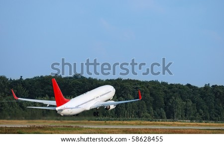 airplane taking off - scene at the airport - stock photo