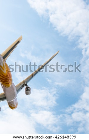 Airplane taking off to Blue Sky - Blue sky with tiny clouds - Boeing777-200 model plane in sky - Cloudscape&Skyscape - stock photo