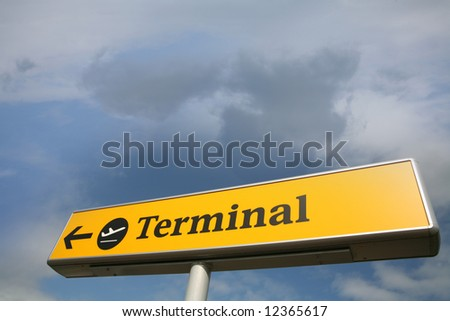 airplane terminal sign  in a blue sky with nice cloud formation