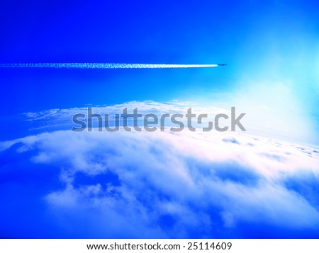 Airplane trail in the blue sky