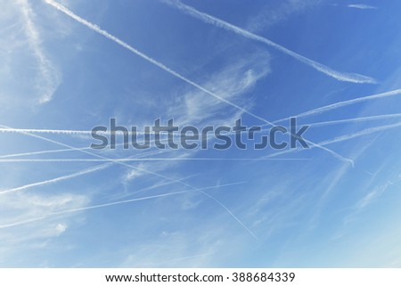 Airplane trails on blue sky