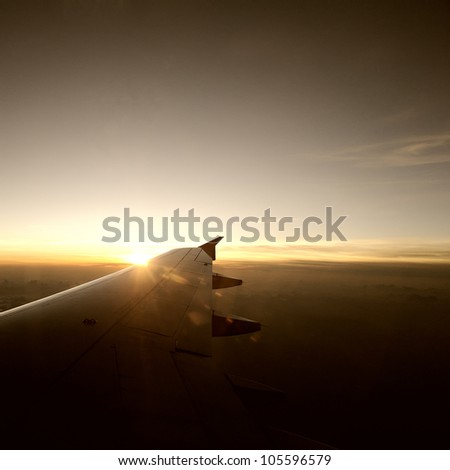 Airplane travel time is sunset. - stock photo